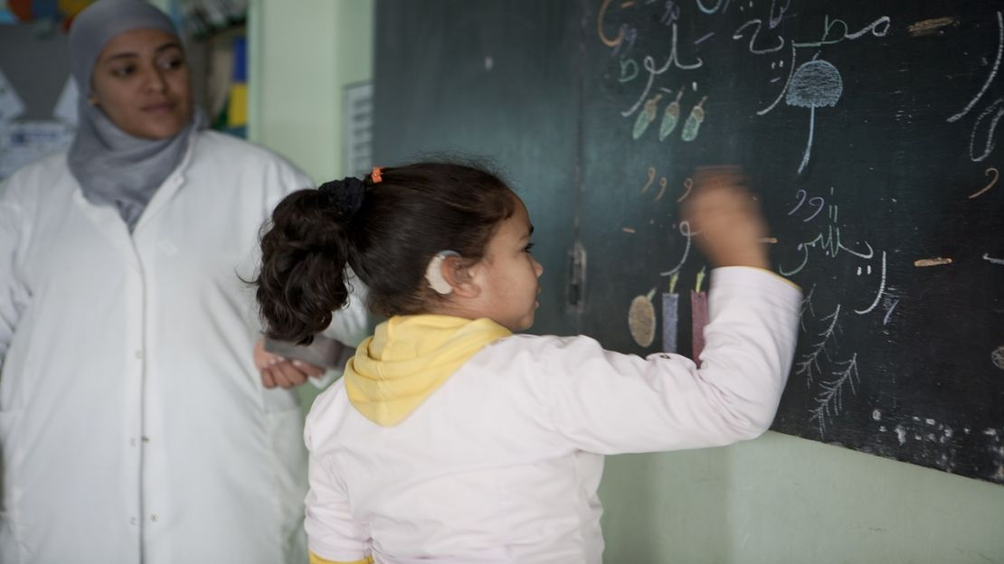 A girl writing on a blackboard, Morocco - Humanity & Inclusion