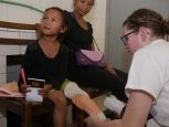 Elinah during the first fitting of her recycled prosthesis in Madagascar