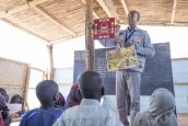 An HI community officer leads a risk education session for children in a school in the Lake Chad region.