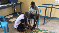 Hakim during the fitting of his 3D printed orthosis in Omugo settlement, Uganda