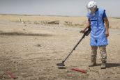 HI's mine clearance teams clearing explosive remnants of war from fields in a bombed village fifteen years ago, during the US military intervention in Iraq.; }}