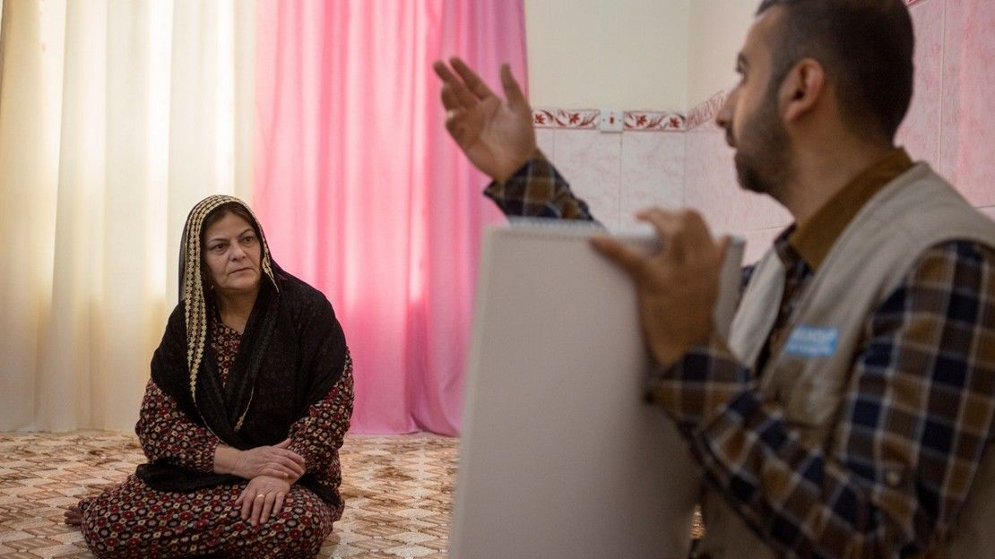 A risk education officer on a home visit in Kifri, Iraq.