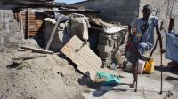 A man with a disability who lost his home during cyclone Idai and is now sleeping in a makeshift shelter.; }}