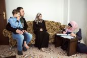 HI voluntary worker, Esra, assesses Ossama's developmental needs.; }}