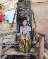 Ma Yin Maung in front of her house in Umpiem Mai camp