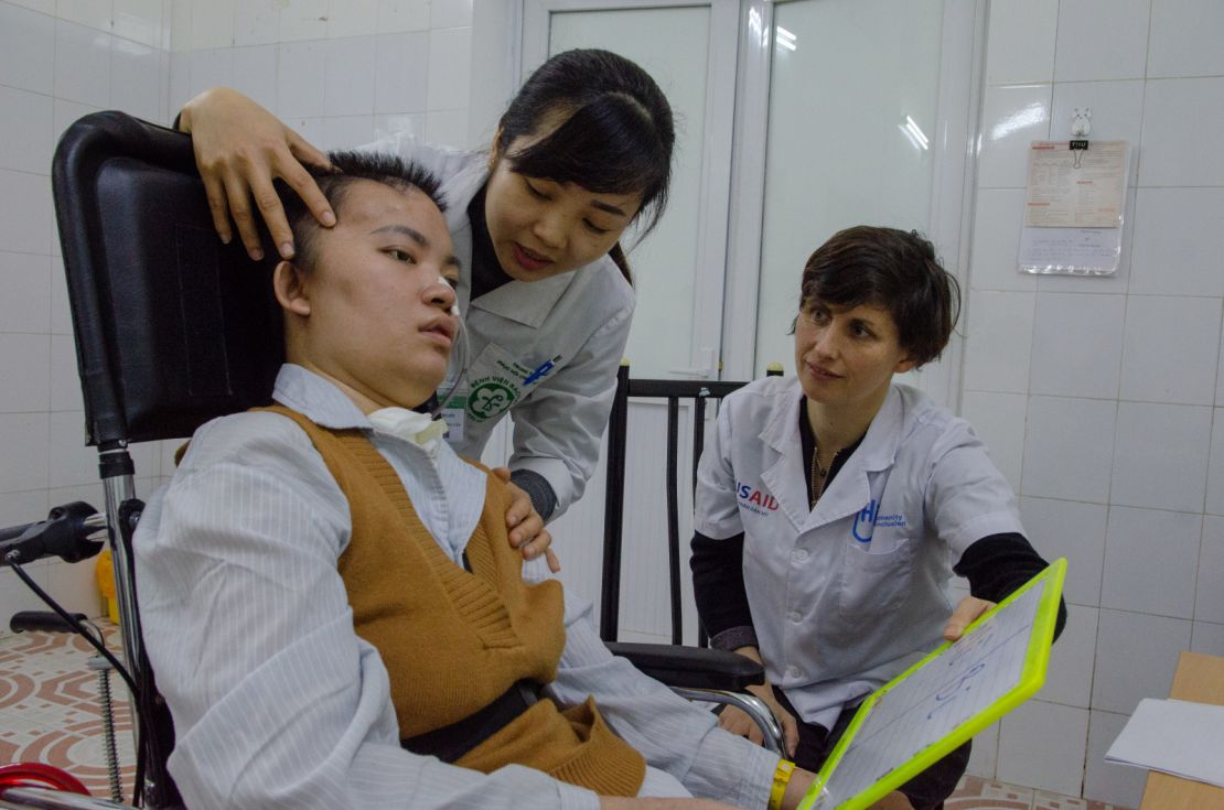 Dr. Dung Le and HI speech therapist Stephanie Wells lead a speech therapy session at Bach Mai National Hospital with Quynh Anh, 30, who suffered a traumatic brain injury