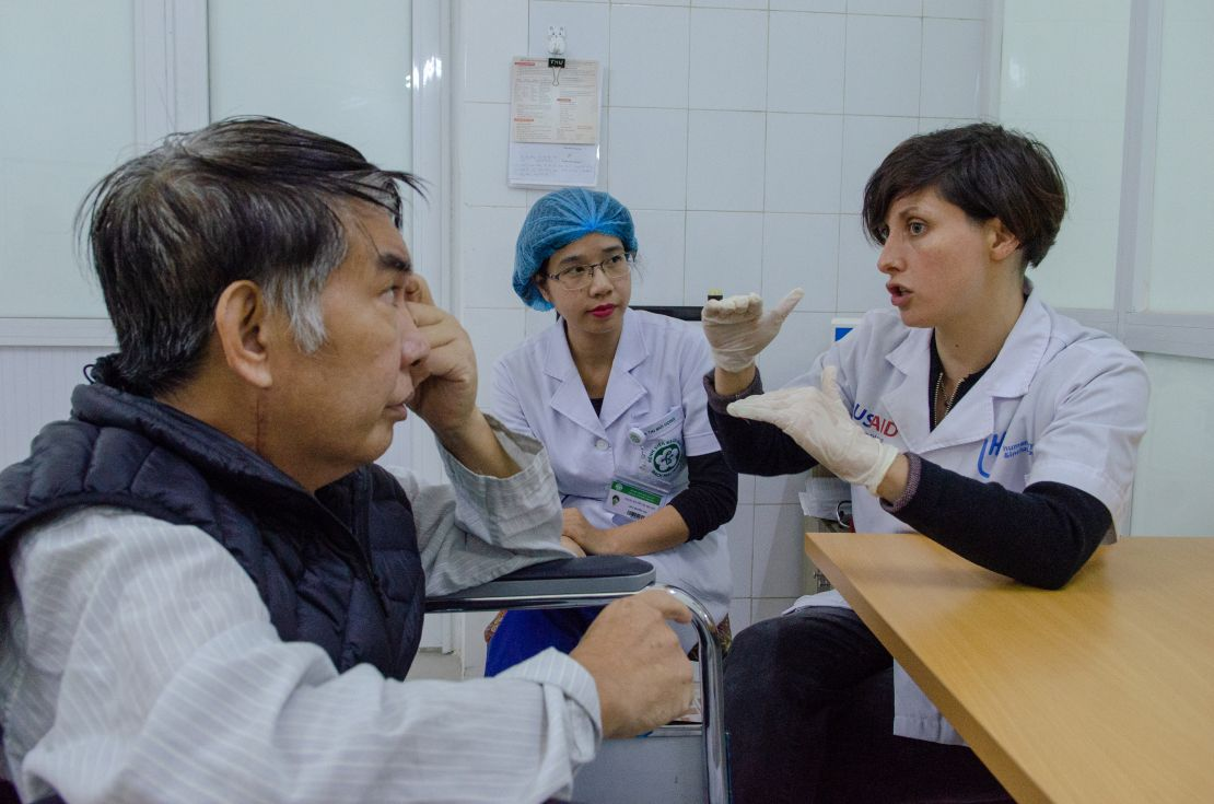 HI speech therapist Stephanie Wells discusses a patient progress with Dr. Duc Nguygen during a speech therapy session at Bach Mai National Hospital