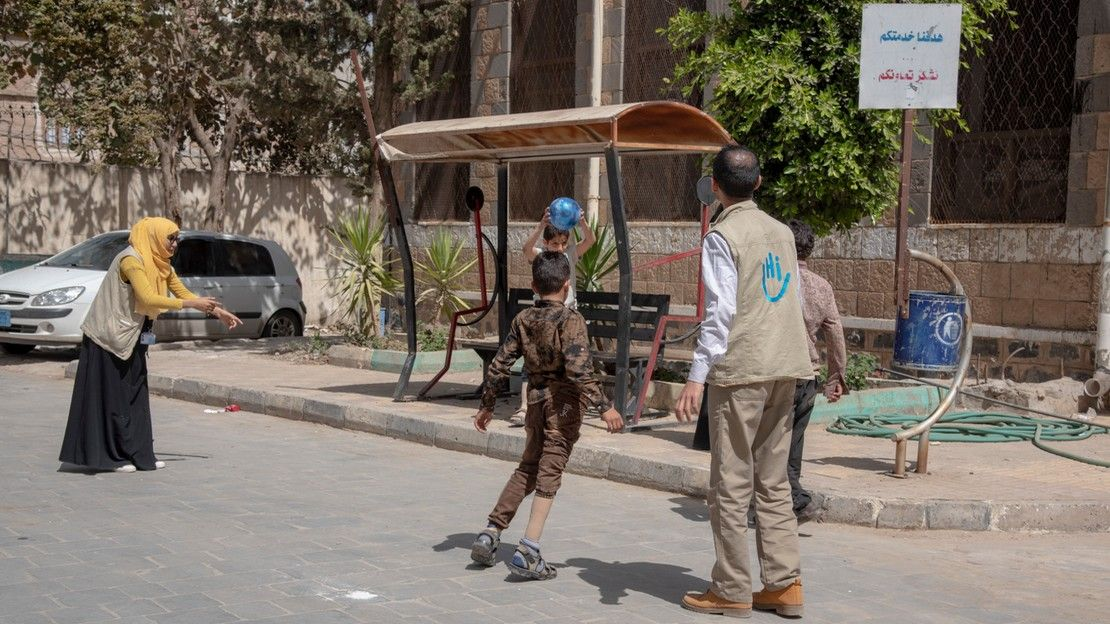 Rehabilitation session with an HI physiotherapist in the courtyard of the centre of Sana'a