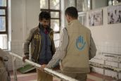 Rehabilitation session with Aiman Al-Mutawaki, a physiotherapist who works for HI in the Sana'a centre.; }}