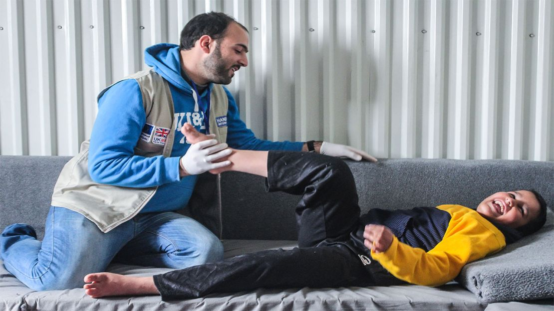 Abdel Rahman, 13, has a physiotherapy session in Azraq camp, Jordan.