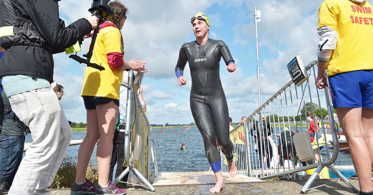 Superhero tri contestant finishing the swim