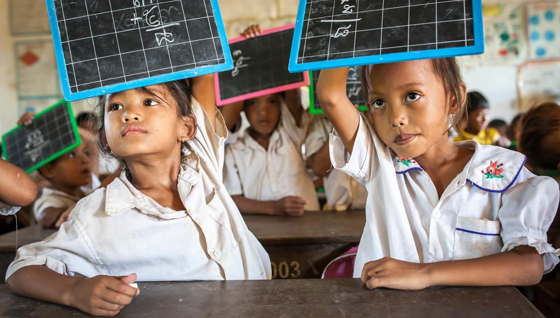 Channa (7 years old) during a mathematics class, Cambodia.