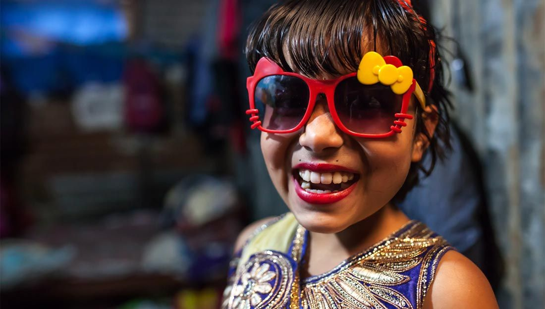 Nirmala, a young amputee, wearing sunglasses, Nepal/
