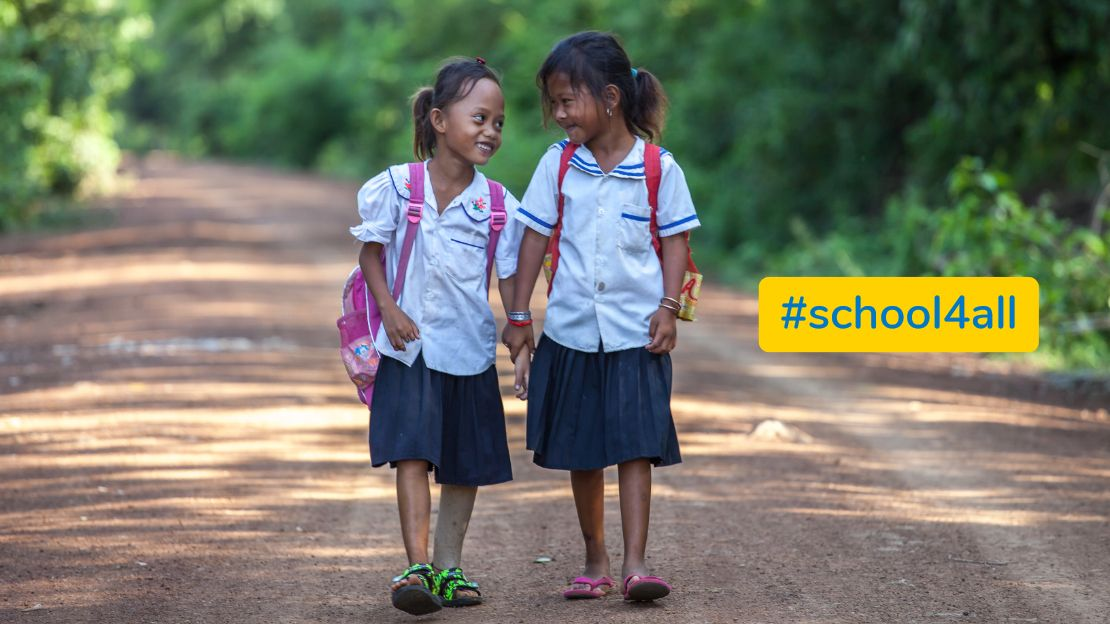 Channa, 7, on her way to school with a friend, Cambodia.