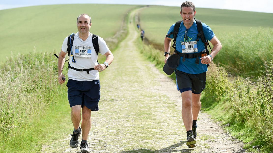 Rupert (right) and his running partner, Al, running the South Downs Way |