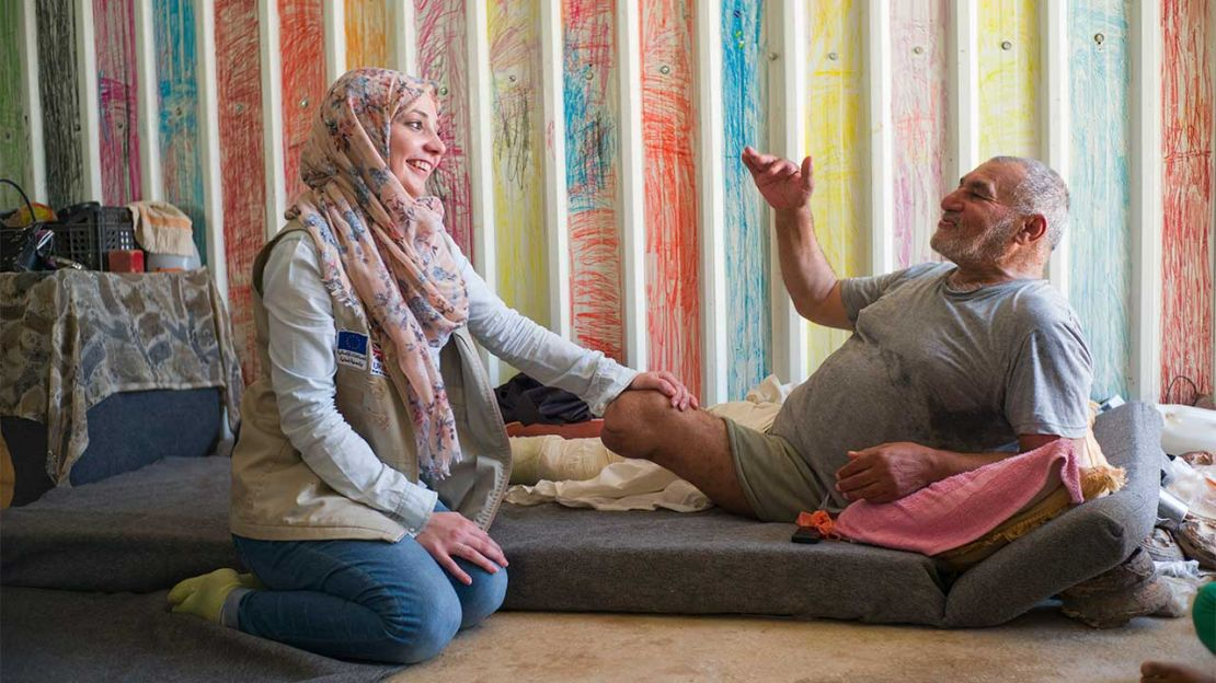 Rajab, 63, with Sally, an HI physiotherapist, in Azraq refugee camp, Jordan.