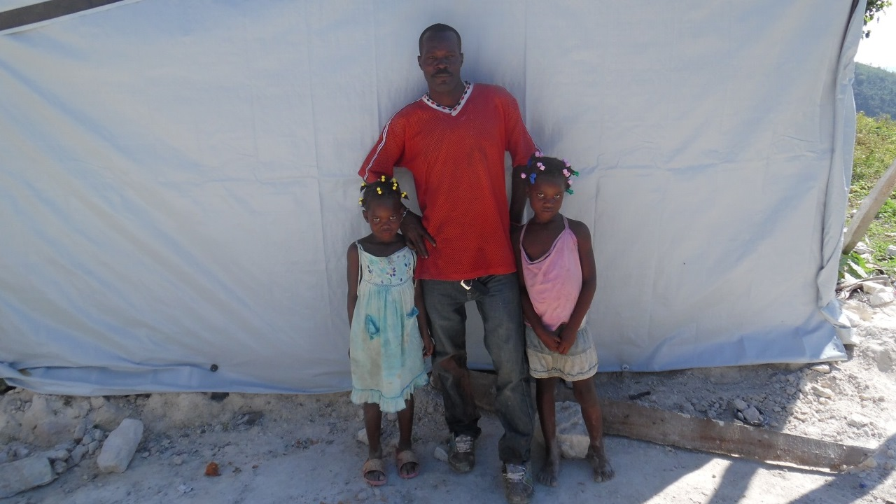 Jeanty Emile and his children lost their house after Matthew hurricane hit Haiti on 4th October 2016.; }}