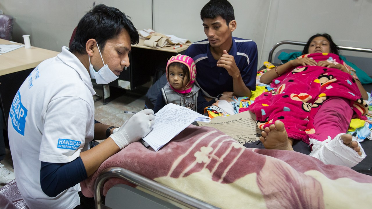 Occupational therapist, Pushpak, assesses the needs of an injured earthquake victim. Nepal.; }}