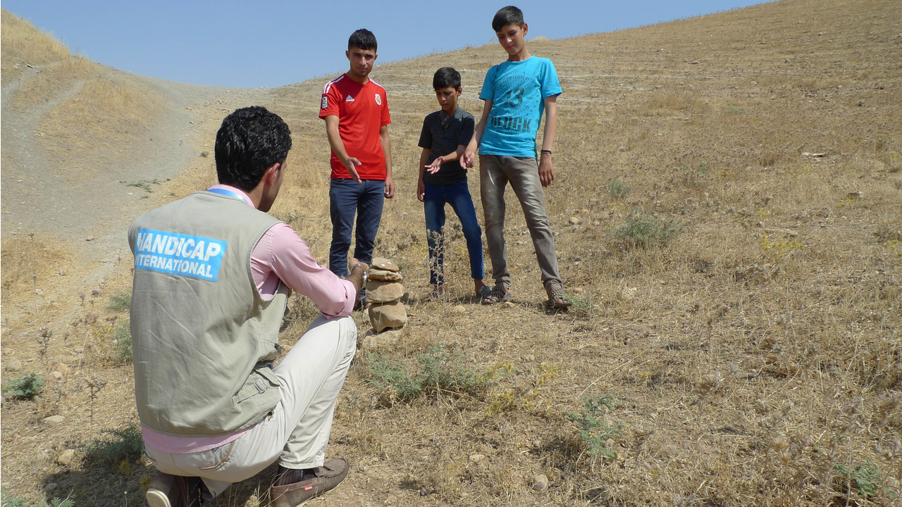 These children found an unexploded device while playing and used the techniques they had learned in the risk education sessions to secure the area while awaiting the demining team.