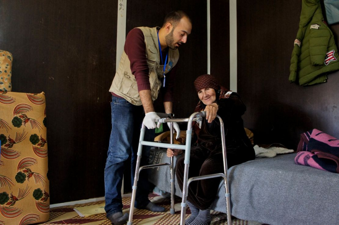 HI Physiotherapist Mo'men does a rehab session with Nawal, a 70-year- old Syrian woman with a hip fracture.