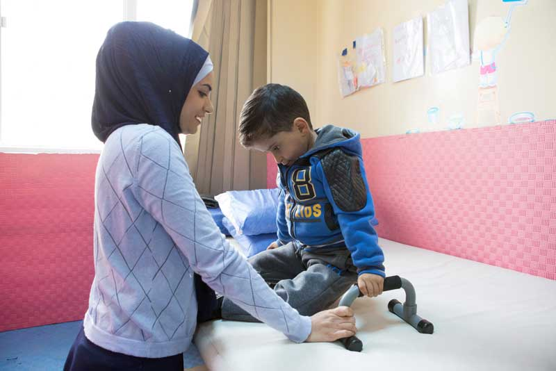 Mohammed attends a physiotherapy session at CDC Zarqa, Jordan.