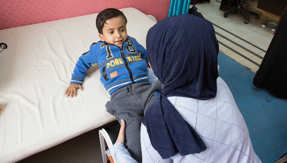 5-year-old Mohammed having a physiotherapy session, CDC Zarqa, Jordan