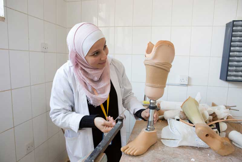 A technician adjusts a prosthesis a Basma Hospital, Jordan