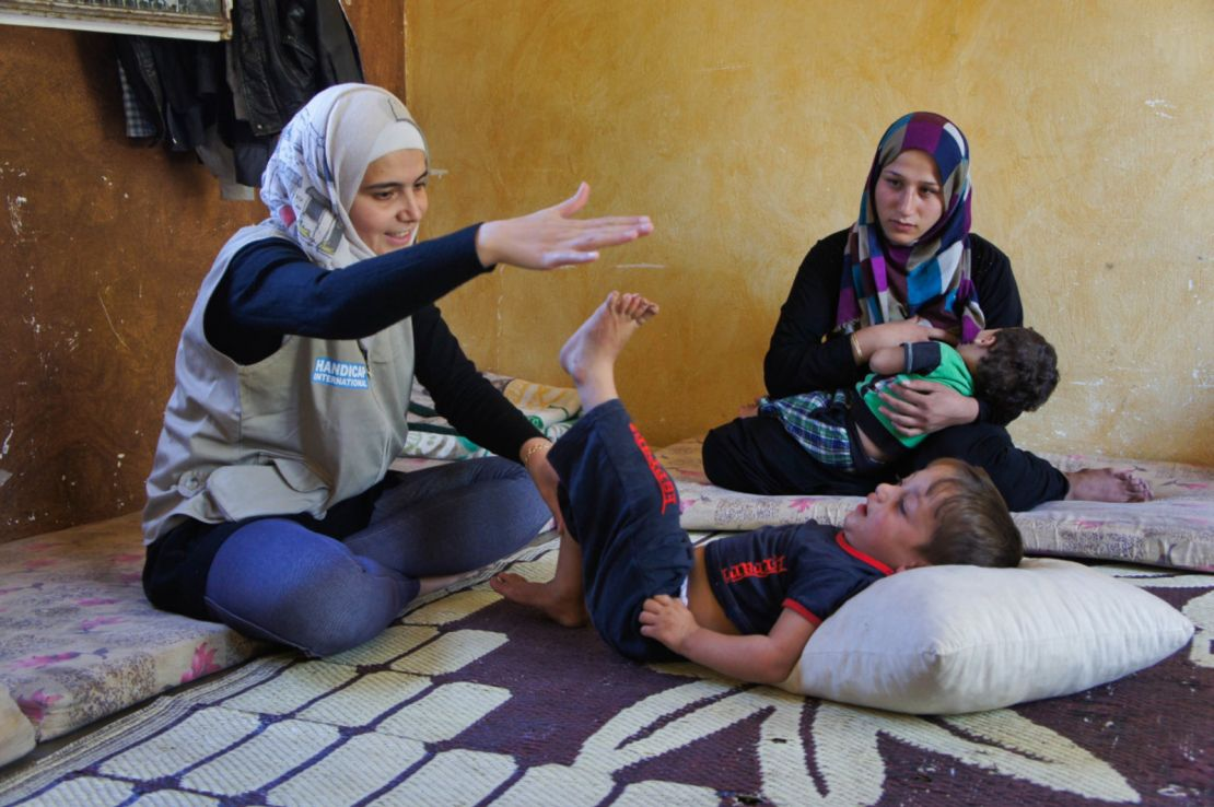 Mariam delivering a rehabilitation session to Fayez, a 3 year-old boy,  in the Bekaa Valley, Lebanon.