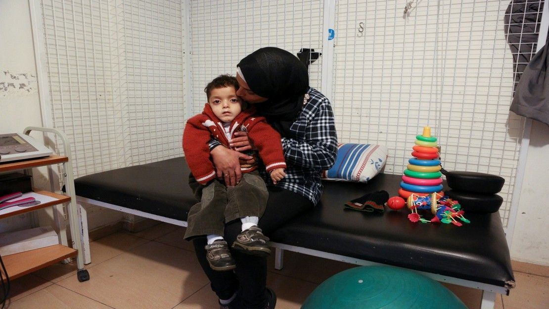 Abdel Kareem, 5, with his mother at the Mousawat rehabilitation centre, Lebanon