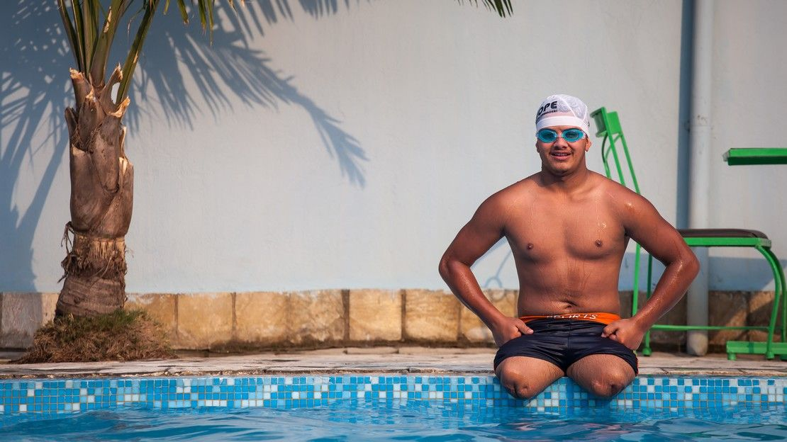 Ramesh training for the Paralympic Games at the swimming pool