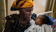 A mother and her child attending the health centre in Bumbu, DR Congo.; }}