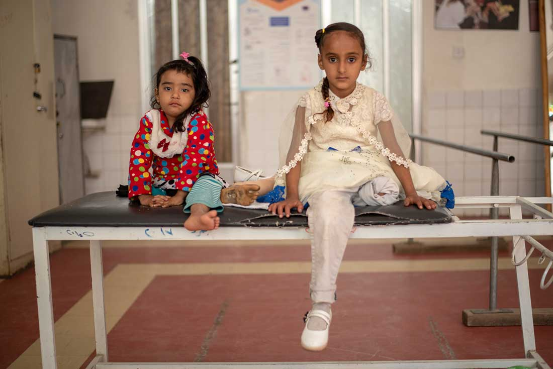 Two young patients from the Sana'a Rehabilitation Centre: on the right, Erada, 7, and on the left her cousin Hala, 4.