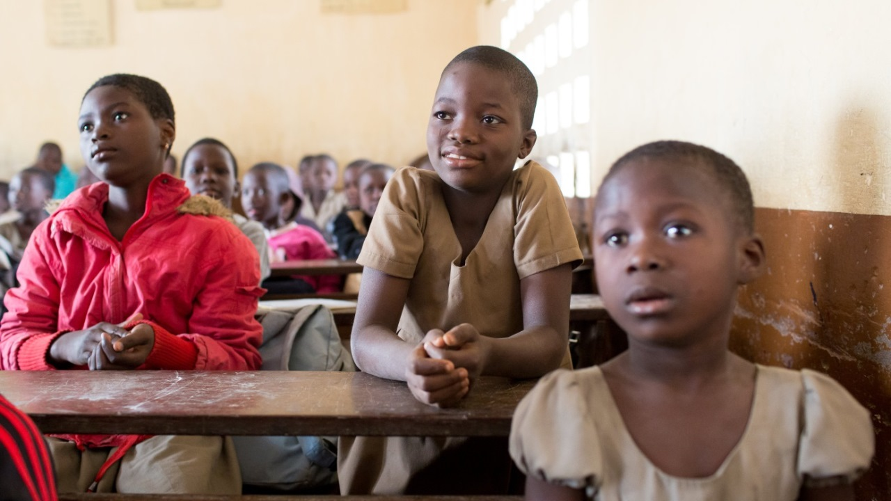 Moussifa, 9 (centre), in a French-language lesson with her second-year primary school class