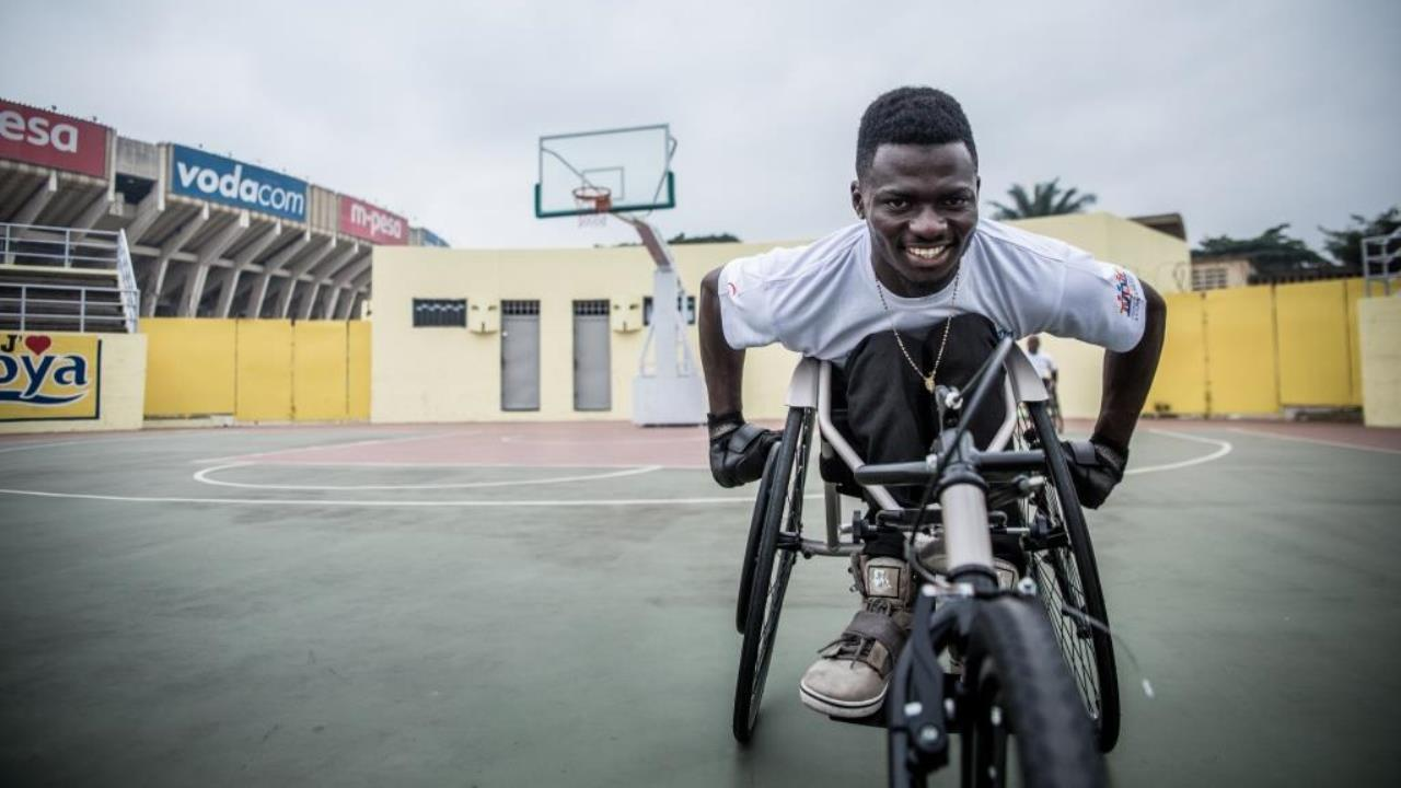 John, an athlete from the DR Congo Paralympic team, warms up before a demonstration of the new racing wheelchairs.