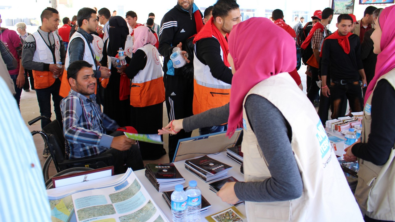 A Handicap International information stand on Mine Action Awareness Day with information to protect people from the dangers of unexploded weapons. Gaza.