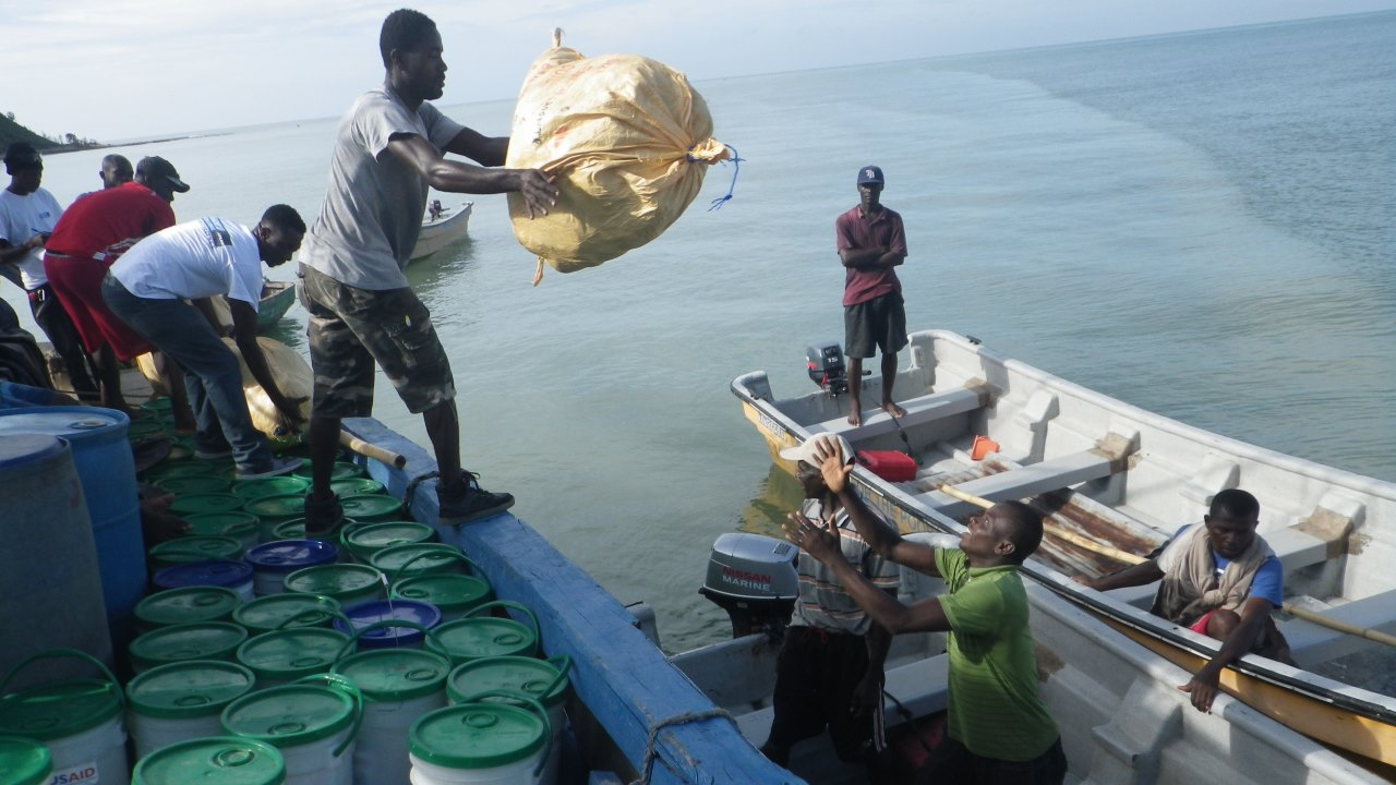 Handicap International emergency teams transporting humanitarian aid from Les Cayes harbour (south of the country) to Tiburon for people affected by Hurricane Matthew.; }}