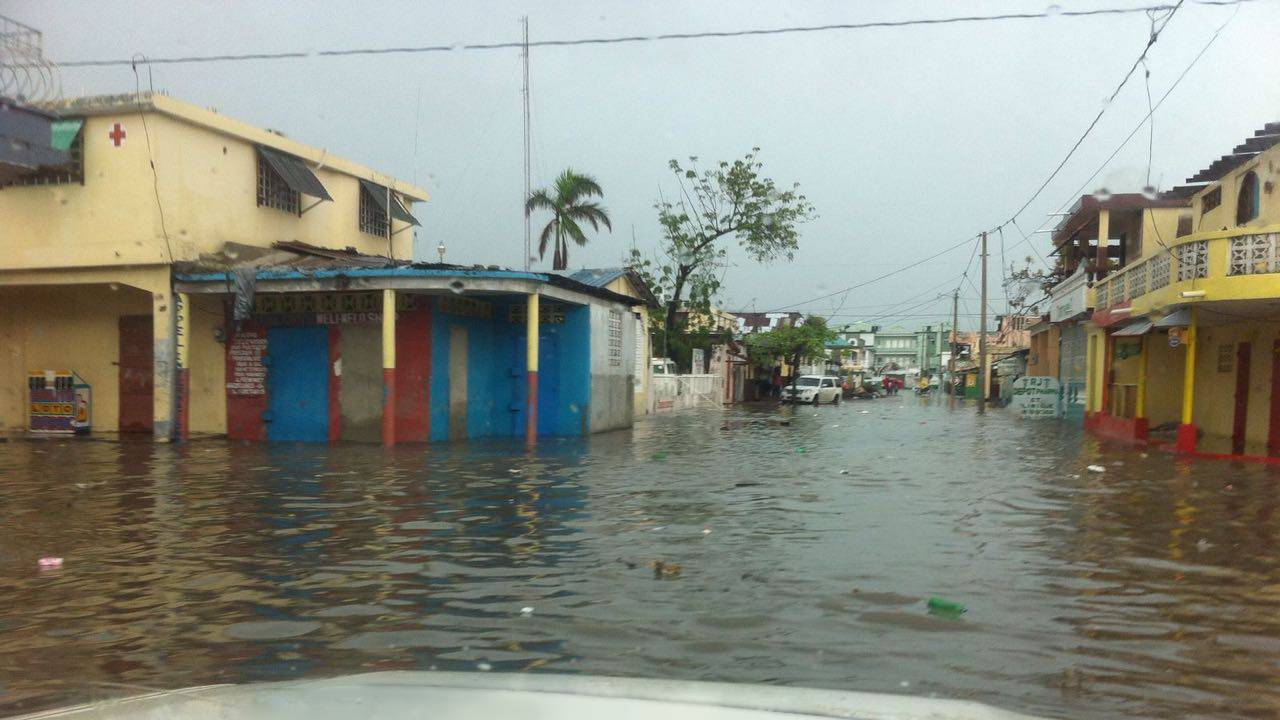 Street in Les Cayes flooded by rain on 20th October 2016.; }}