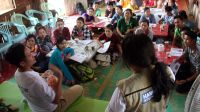 Training parents on child stimulation in Mae La refugee camp, Thailand.; }}
