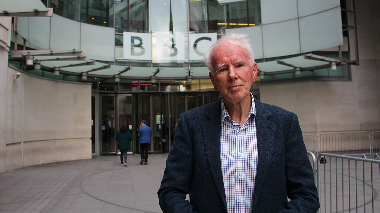 Broadcaster and journalist Mike Wooldridge standing outside the BBC.