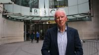 Broadcaster and journalist Mike Wooldridge standing outside the BBC.; }}
