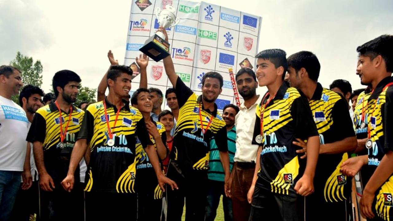 The Kupwara Tigers lift the trophy after an inclusive cricket match organised by Handicap International; }}
