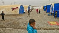Children playing in Khazer camp, one of the biggest camps hosting displaced persons from Mosul and the region.; }}