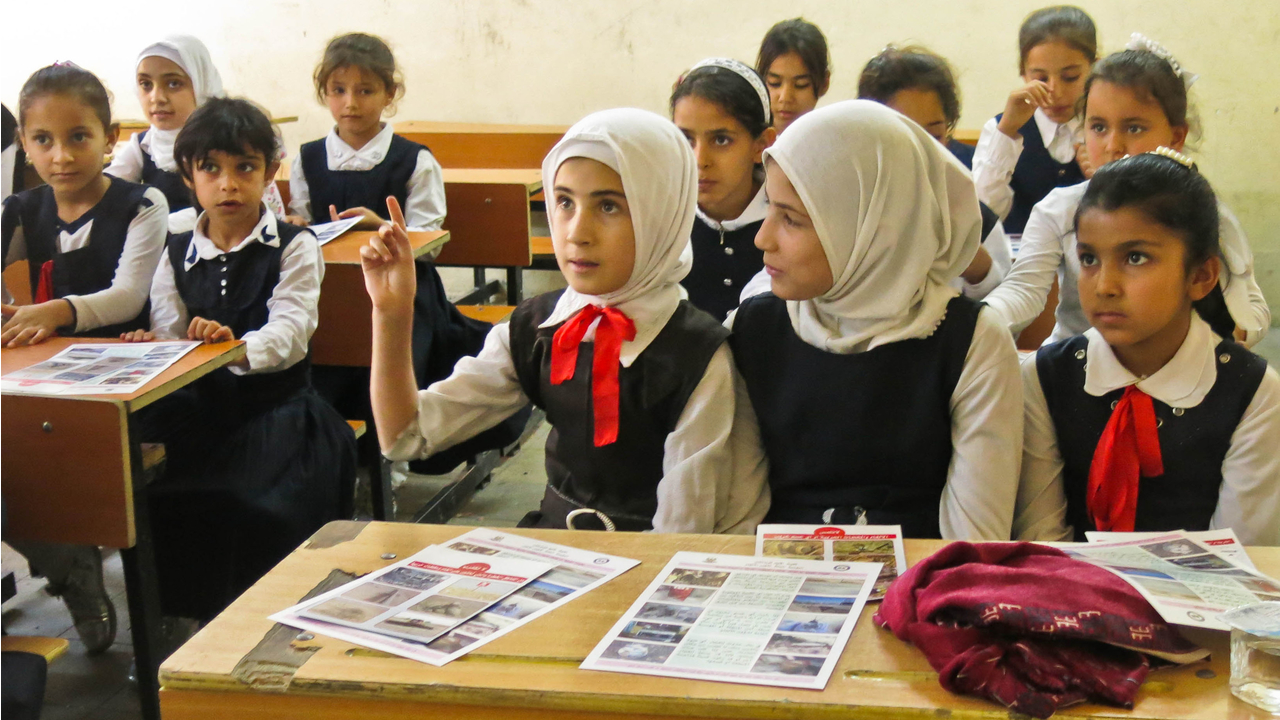 Girls take part in a mine risk education session at a school in the governorate of Kirkuk, Iraq.; }}