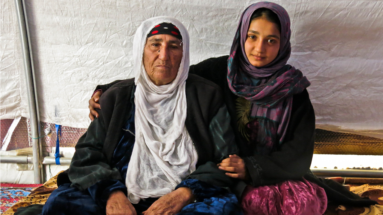 Reema with her granddaughter Dhoha in their tent in  Khazer camp. ; }}