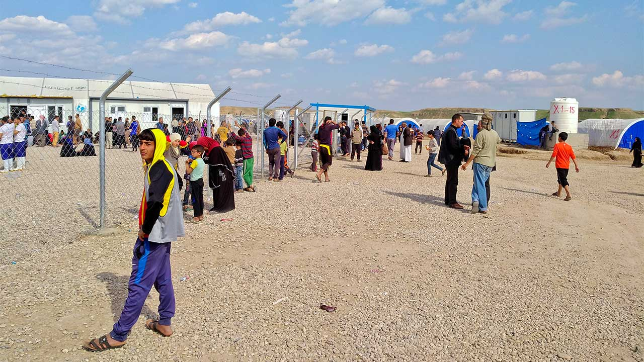 Iraqis in a camp for internally displaced people; }}