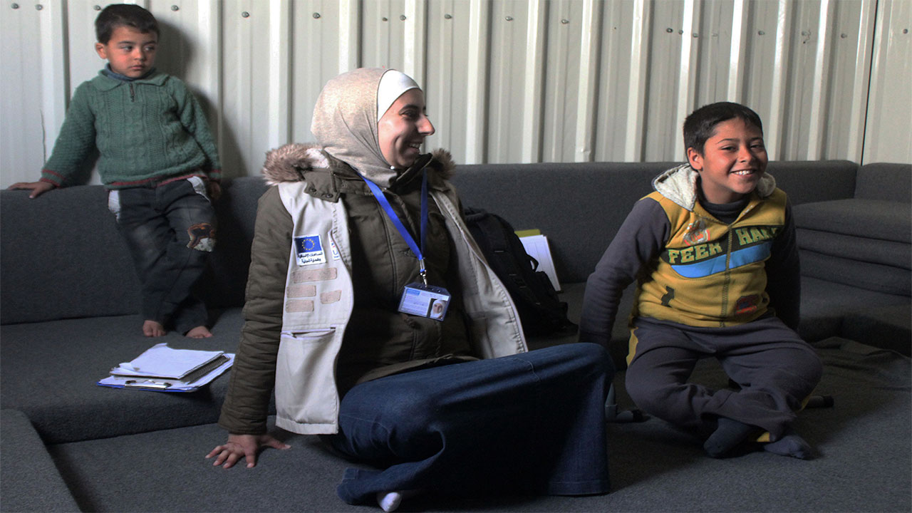 Ahmad and physiotherapist Noor during a rehabilitation session in Azraq refugee camp. Jordan.