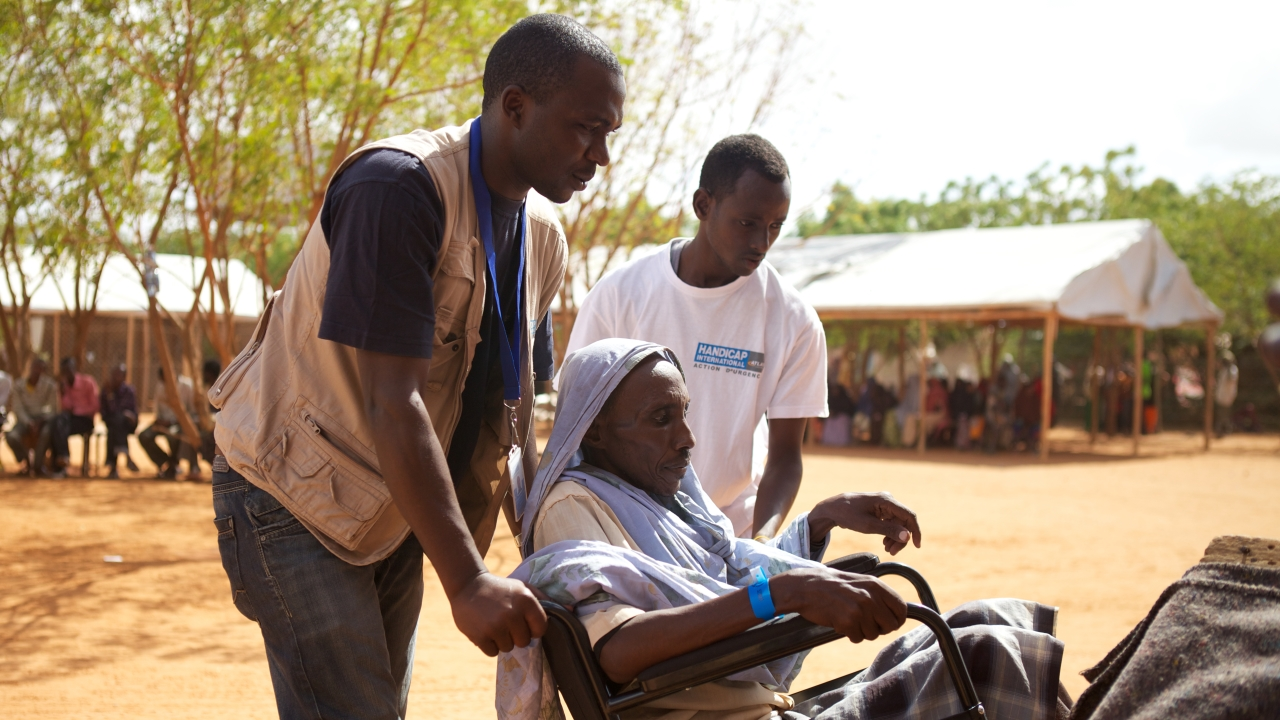 A person with disabilities being cared for in a camp in Dadaab. ; }}