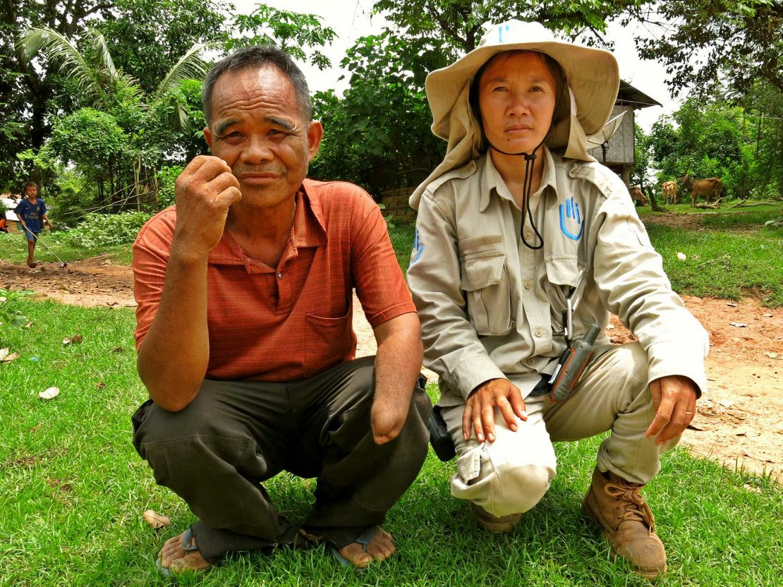Lumngen with Eian, a cluster munition survivor, Laos.