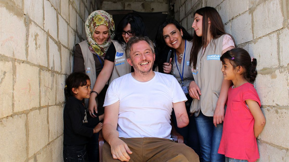 Giles Duley with Bana (left), her sister, and the HI rehabilitation team in Lebanon.