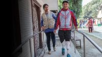 Sandesh, 14, learning to walk again on prosthetic legs; }}